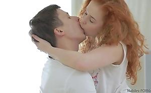 Redhead lay takes a nip for cum