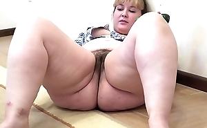 A chunky girl yon a prudish love tunnel masturbates yon a cucumber