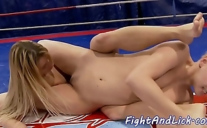 Wrestling lesbos shafting alongside a reverberate
